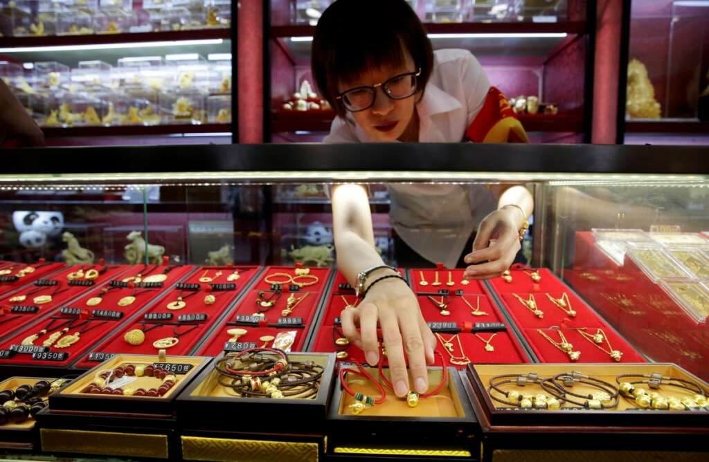Gold gains as markets count economic toll from coronavirus