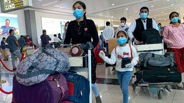Combating, coronavirus, Over 275,000, Indians, UAE, fly back, home