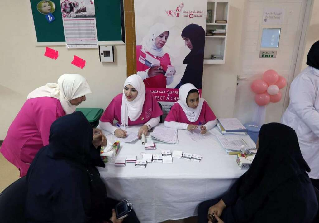Hospital staff from Umm Al Quwain hospital interviewing patients at the Pink Caravan.-Photo by Leslie Pableo