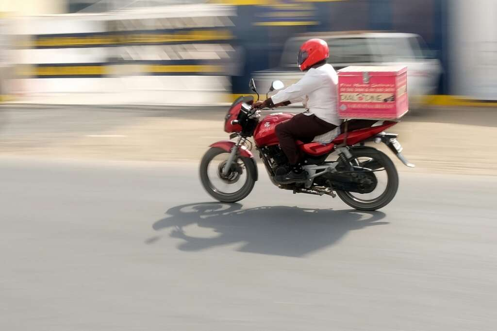 Delivery boy on the way to deliver food from a restaurant in Dubai.— KT file photo