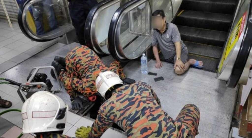 breaks leg, escalator, slipper, stuck, kuala lumpur, malaysia, trapped, leg