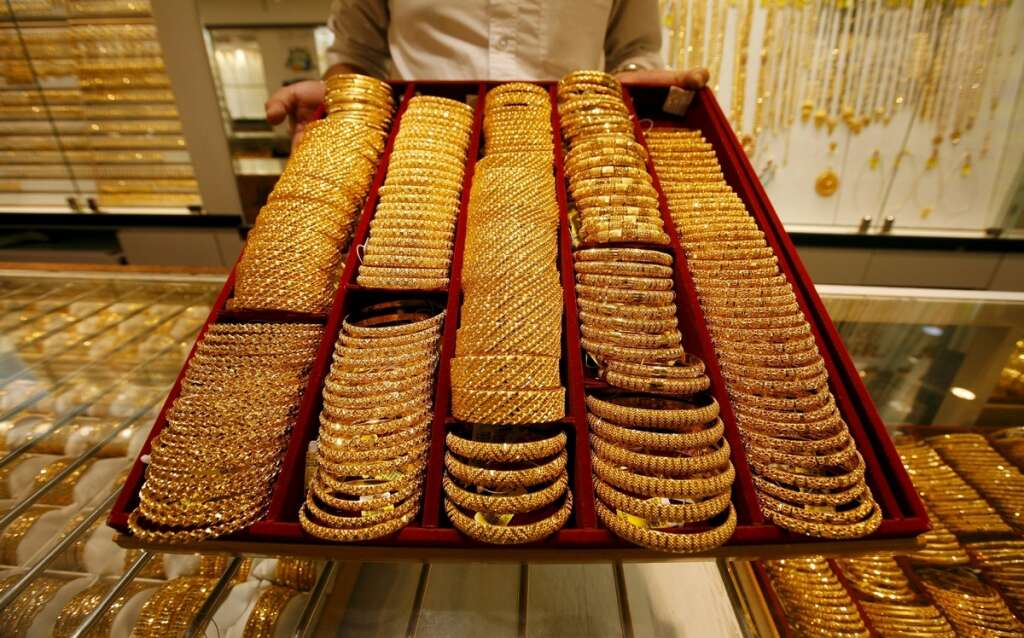 Gold falls after dollar firms up, 24k priced at Dh153 75