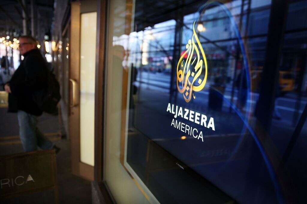 The logo for Al Jazeera America is displayed outside of the cable news channels offices in New York City.