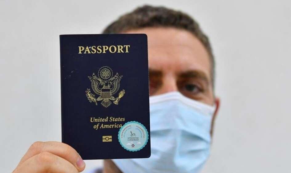 dubai, coronavirus, covid-19, DXB, dubai airport, passport sticker