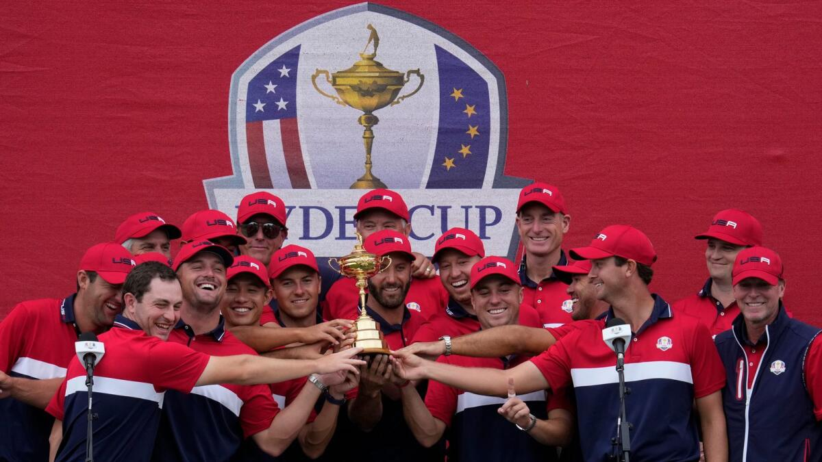 Team USA players pose with the trophy after their Ryder Cup win. (AP)
