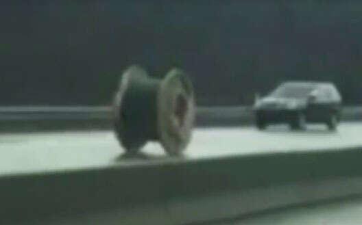 Watch: Giant wire spool falls of truck, rolls down highway