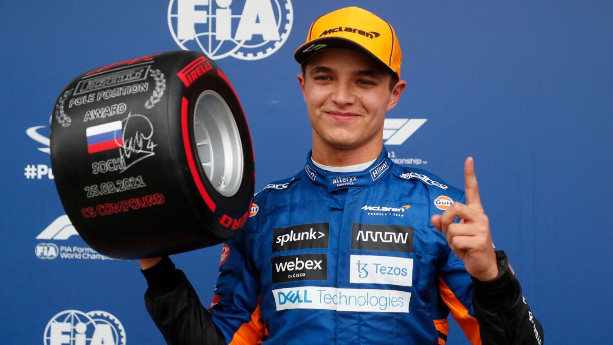 McLaren's Lando Norris celebrates after taking pole position for the Russian Grand Prix at the Sochi Autodrom circuit on Saturday. — AP