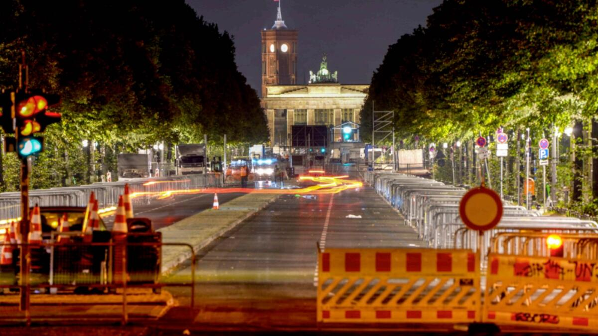 Traffic lights stand at the road leading to the Brandenburg Gate in Berlin, Germany, early Monday, a day after the German elections. — AP