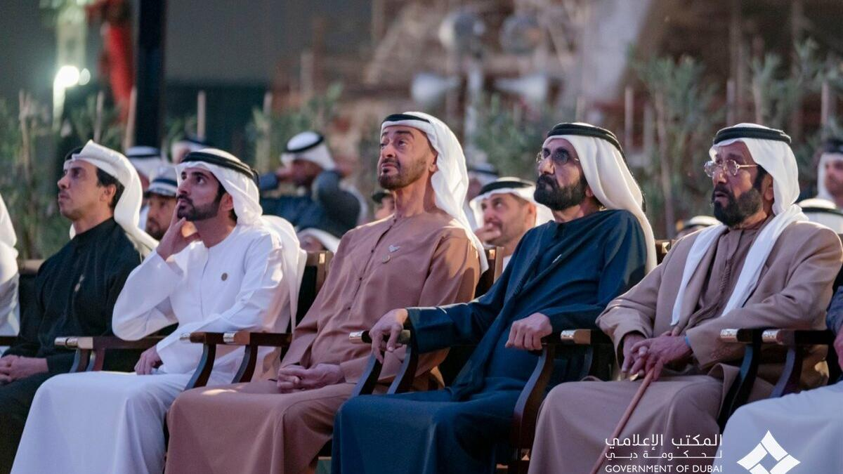 UAE leaders watch a display on the Al Wasl Plaza.