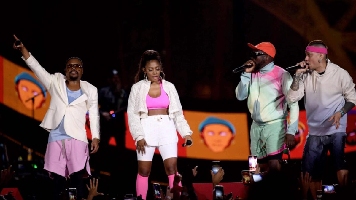 US pop band Black Eyed Peas members perform during a 'Global Citizen Live' concert in Paris. — AFP