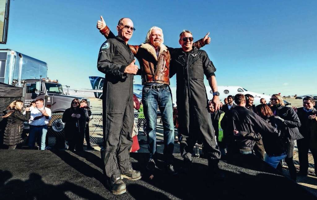 Virgin chief Richard Branson with Mark Stucky and his co-pilot after their spaceship's successful flight to the edge of space.