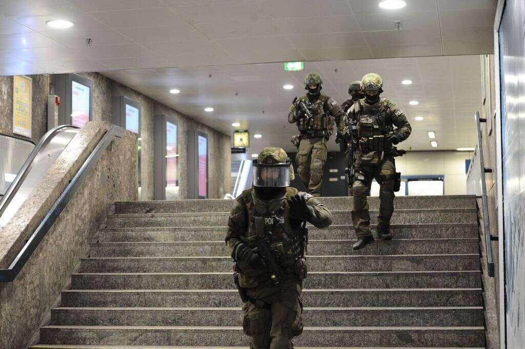 Heavily armed police forces walk through the underground station Karlsplatz (Stachus) after a shooting in the Olympia shopping centre was reported in Munich, southern Germany