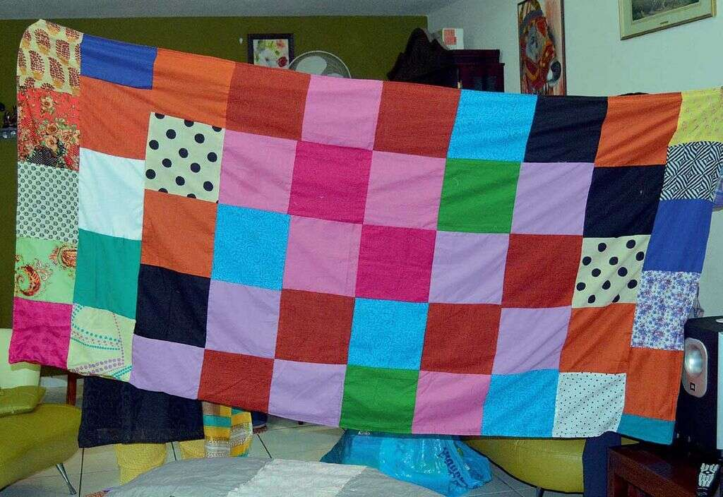 A bedsheet made from scraps of fabric, which are usually discarded by boutiques.